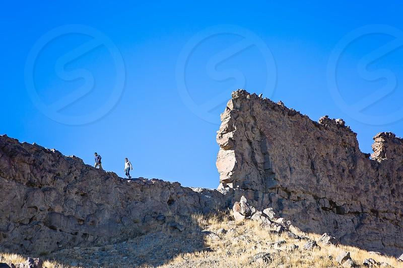 Father and Son on a road trip hiking Shiprock Arizona photo