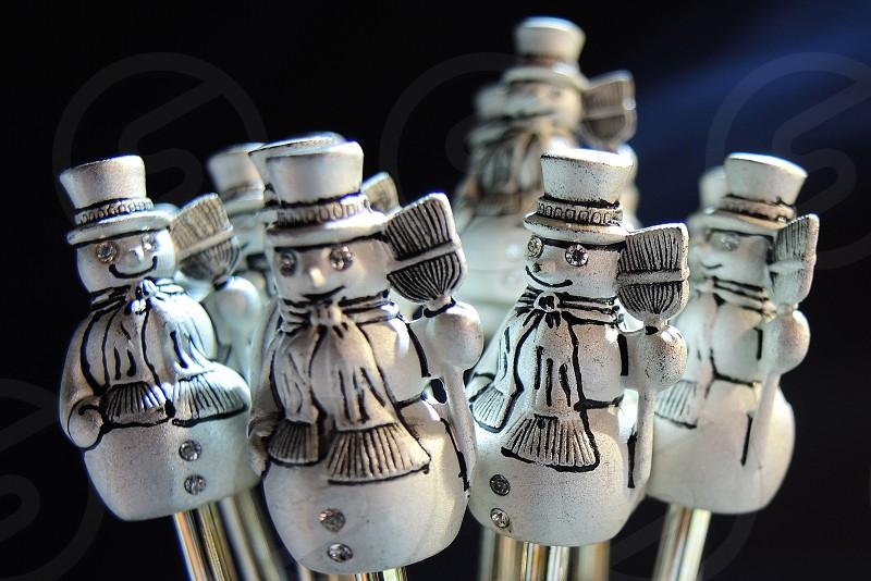 white snowmen on sticks decor photo