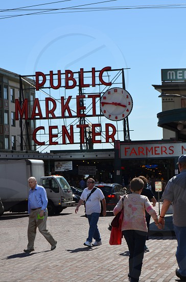 A candid photo of people entering Pike's Market in Seattle Washington photo