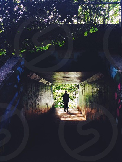 person standing in tunnel photo