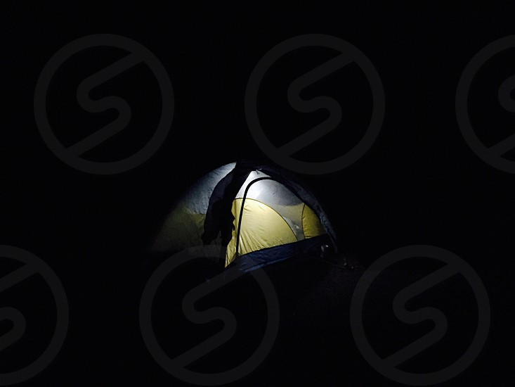 Tent night light camping CO live outside photo