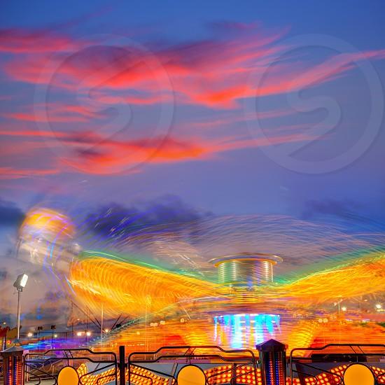 Denia in Alicante sunset with fairground fair at Spain photo