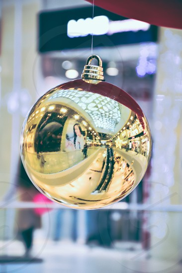 Christmas Gift Holiday Christmas Ornament Christmas Decoration Gold Colored Red Ribbon Illuminated Decoration Celebration Defocused Bow Shiny Bright Sphere Season Wrapped Glowing Ornate Ethereal Multi Colored No People Curve Vibrant Color Copy Space Softness dof Concepts And Ideas Holidays And Celebrations  photo