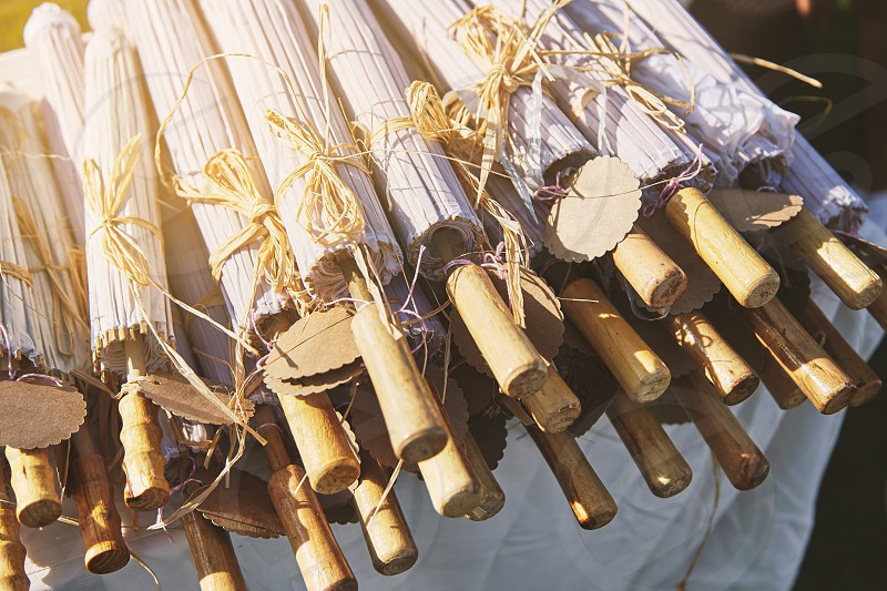 Close-up a pile of Chinese wooden umbrella paper folding with empty name tag one of the favorite items for wedding souvenir photo