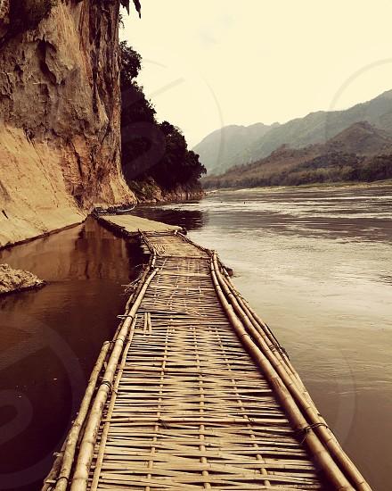 beige wooden bridge near brown cliff photo