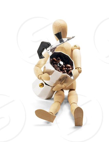 wood mannequin and coffee machine filled with coffee beans isolated on white background photo