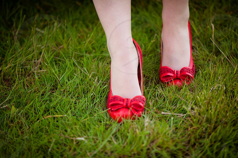 red shoes feet grass photo