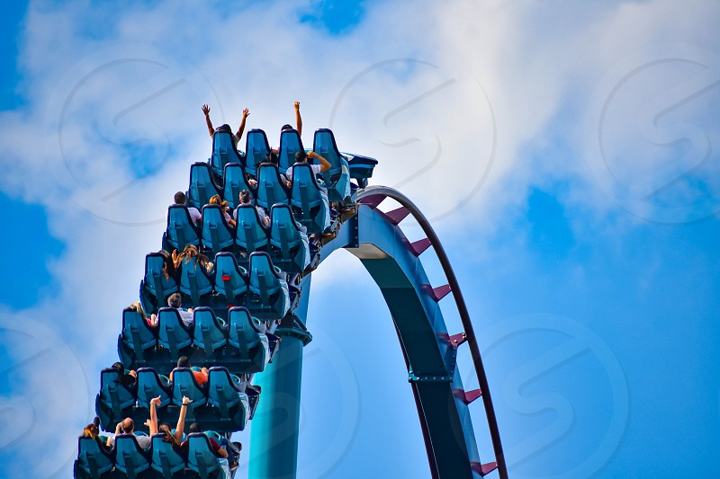 Orlando Florida . February 17  2019. People having fun Mako Rollercoaster on lightblue cloudy sky bakcground at Seaworld   (3) photo