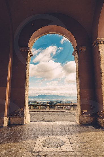 Italy Perugia archway perfect day clouds symmetry  photo