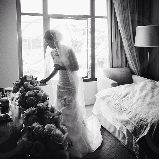 bride standing near bed photo
