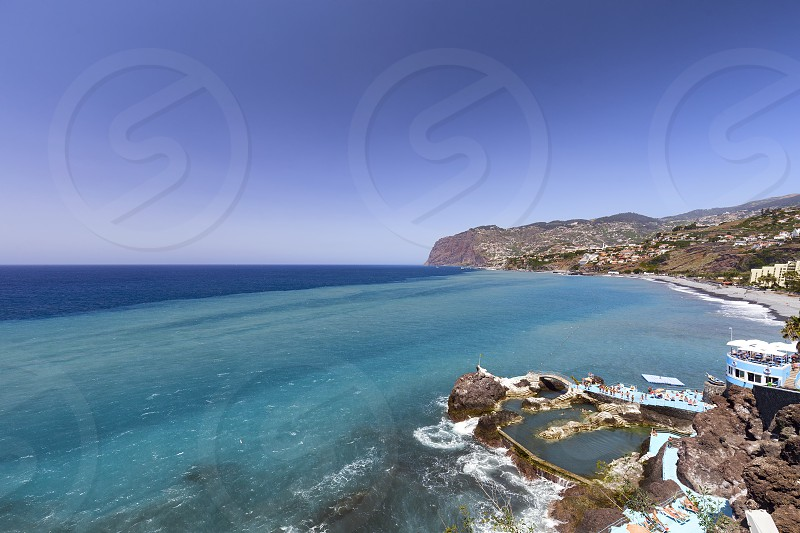 Salt water ocean pools near the town of Sao Martinho in Madeira Portugal.  photo