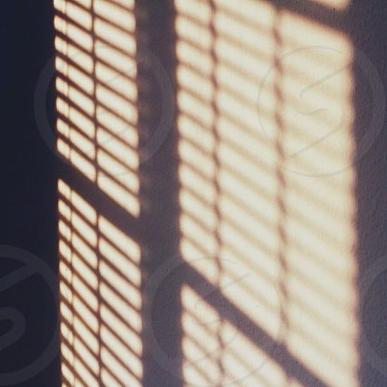 window shadow on wall photo
