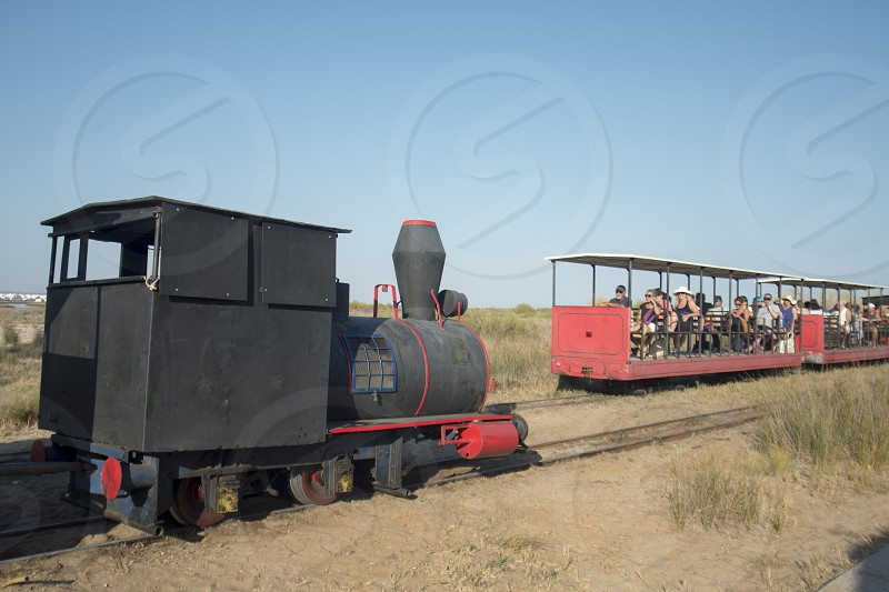 the transport train to the Anchor cemetery at the Barril beach near the Town of Tavira at the east Algarve in the south of Portugal in Europe. photo
