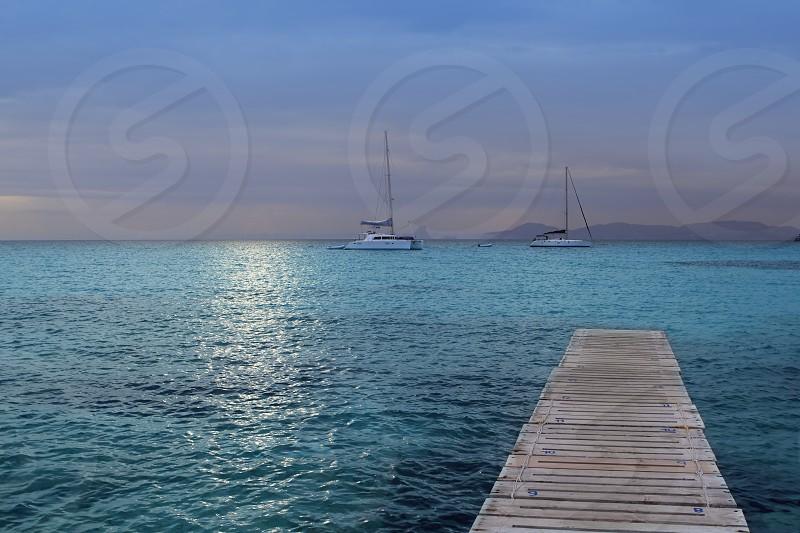 magic silver turquoise Formentera sunset wooden pier balearic islands photo