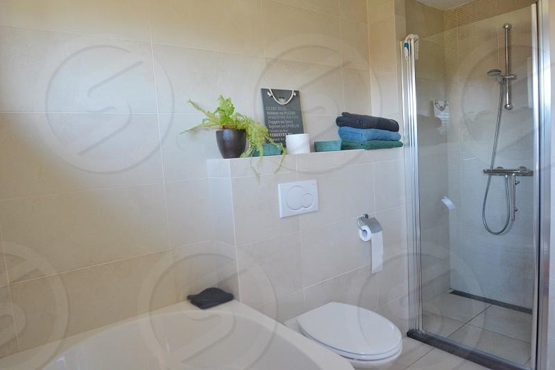 bathroom toilet towelsbathshowerinterior  photo