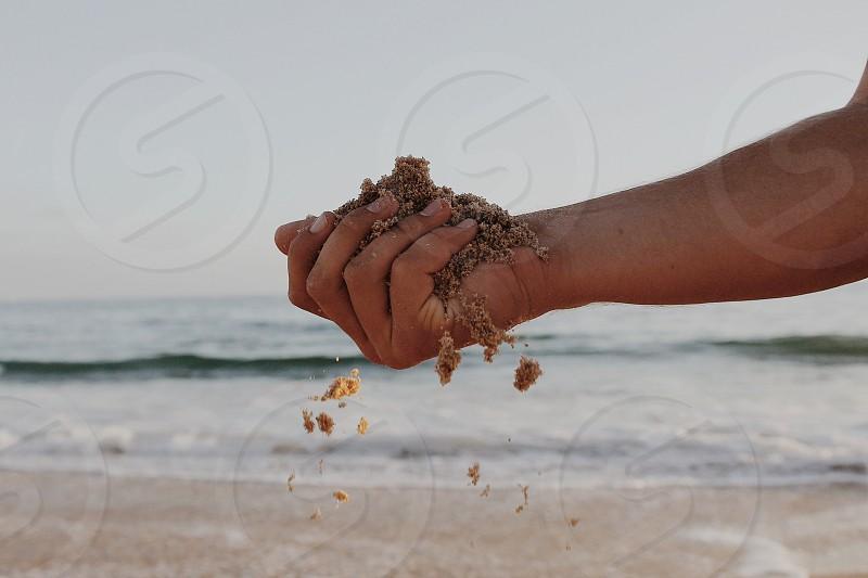 Sandy hand photo