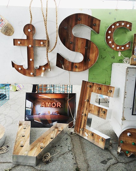 brown anchor figure beside black flat screen television photo