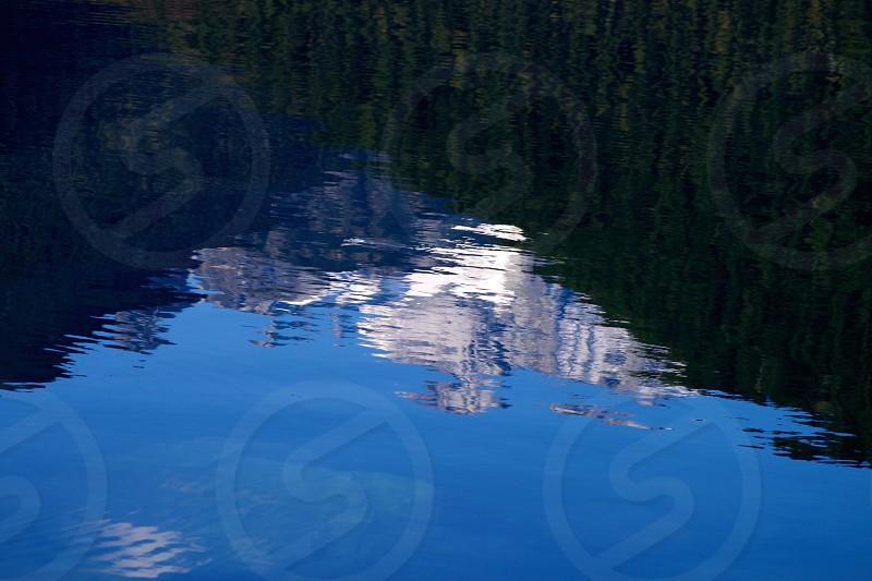 Mountain reflecting into a lake photo