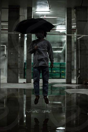 Action shot abandoned umbrella  photo