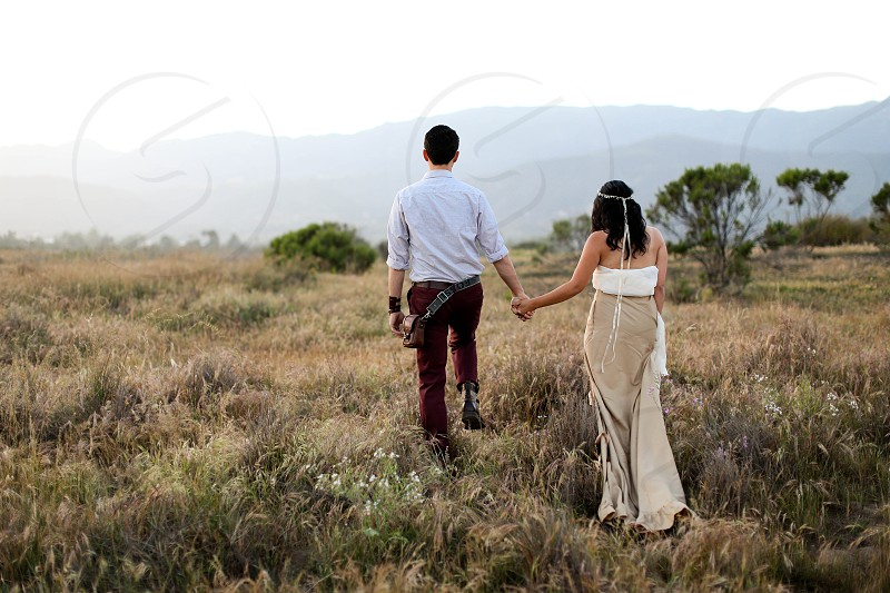 couple field bohemian bride photo