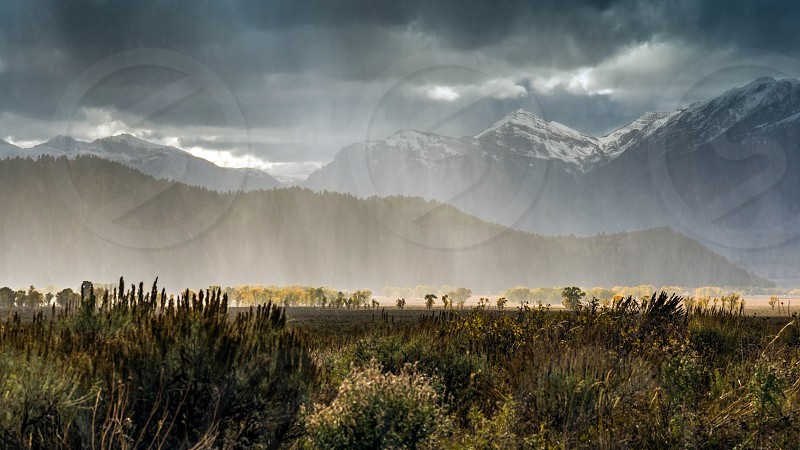 Snow Storm Sweeping in from the Grand Teton Mountain Range photo