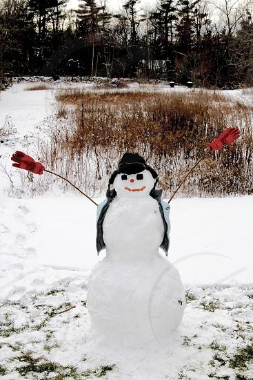 snowman with black hat figure photo