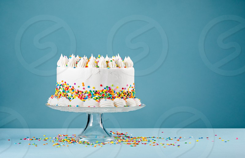 Phenomenal White Birthday Cake With Colorful Sprinkles Over A Blue Background Funny Birthday Cards Online Elaedamsfinfo