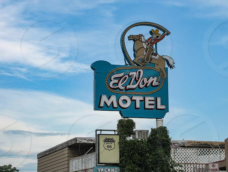Neon advertising sign for El Don Motel on Central Avenue Albuquerque New Mexico formerly Route 66. Western roping cowboy and horse in mid-century modern style. 2222 West Central photo
