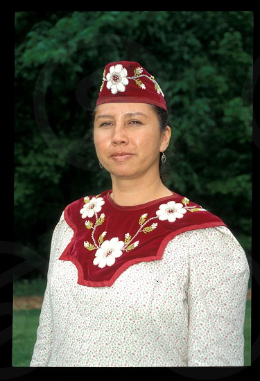 Iroquois woman (Cayuga) dressed in traditional raised beadwork Howes Cave New York. photo