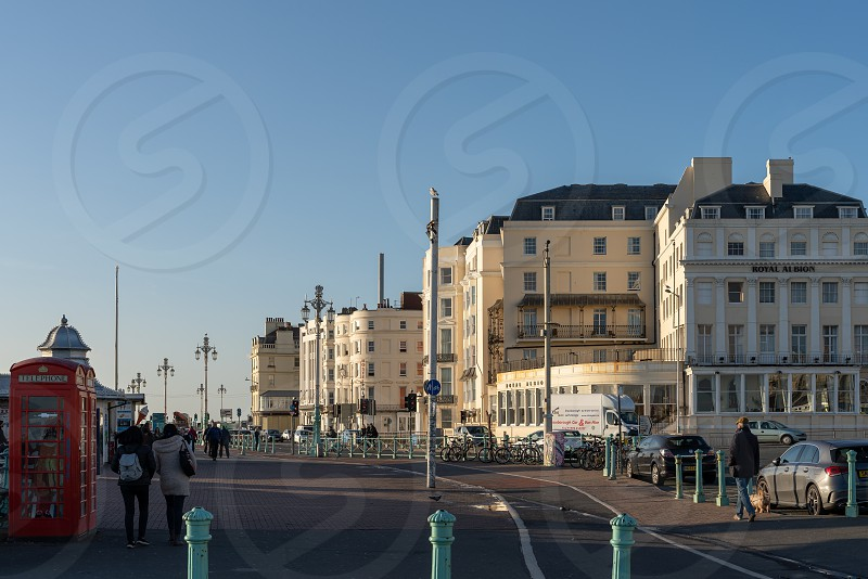 BRIGHTON EAST SUSSEX/UK - JANUARY 8 : View of buildings along the seafront in Brighton East Sussex on January 8 2019. Unidentified people photo