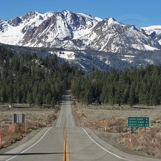 snow mountain on road view photo