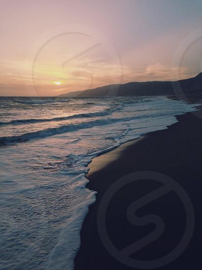 Beach sunset waves Malibu California sand photo