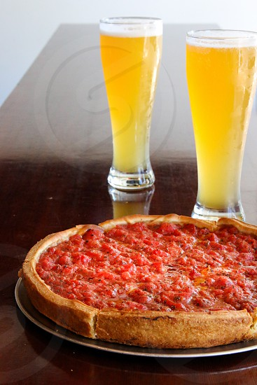 Chicago pizza and two beers photo