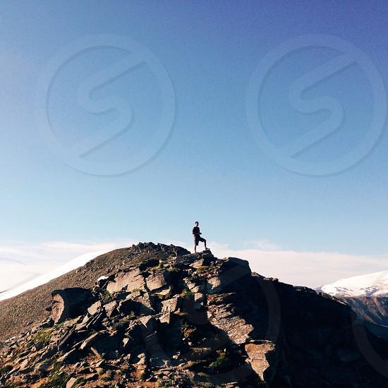human standing on brown rocks photo