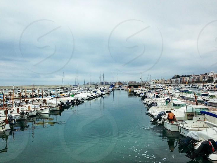 white sailboat on pier photo