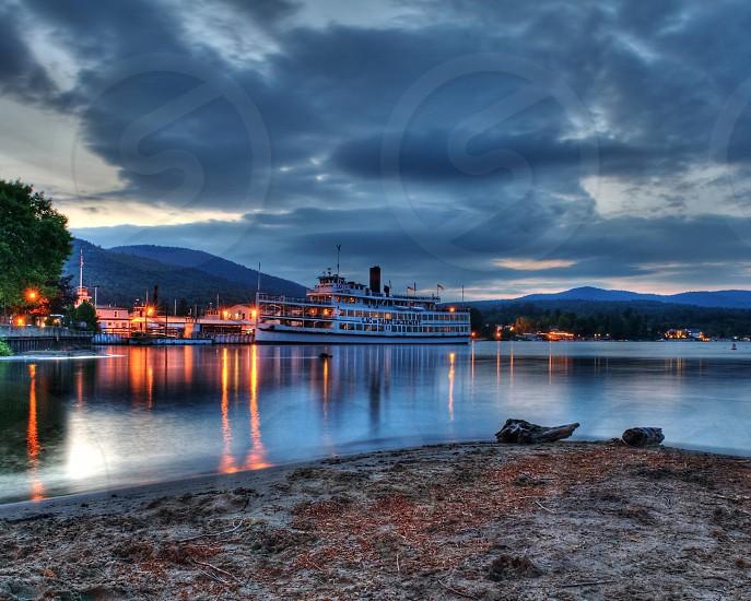 cruise ship  on sunset photography photo
