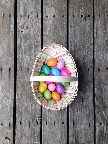 Easter basket with colorful eggs  photo