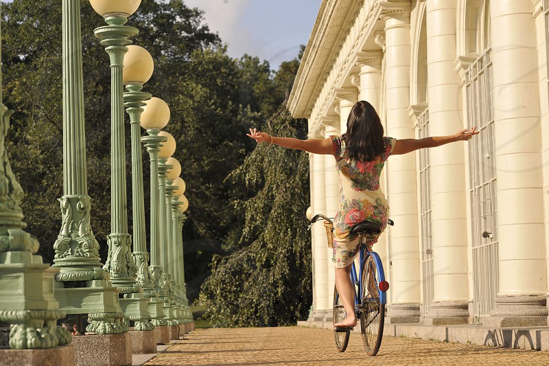 woman on a bicycle riding photo