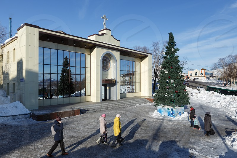 PETROPAVLOVSK KAMCHATKA RUSSIA - JAN 6 2018: Diocesan Spiritual and Enlightenment Center of Petropavlovsk and Kamchatka Diocese of Russian Orthodox Church and Christmas tree in front of building. photo