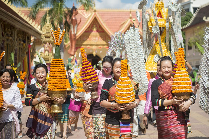 People at a ceremony at the Wat Si Muang Temple on the That Luang Festival in the city of vientiane in Laos in the southeastasia. photo