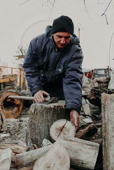 Man ax wood tree hands forester woodman work photo