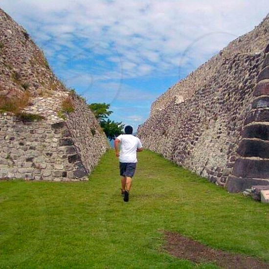 Running through the ruins of the mexican pyramids.  photo