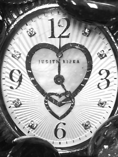 Watch dial with two hearts photo