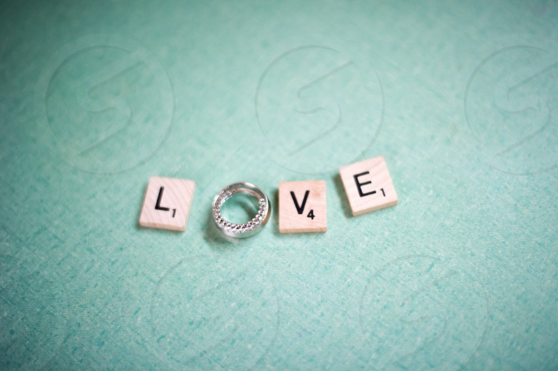 wedding rings and scrabble pieces spelling love  photo