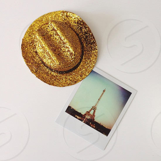 Eiffel tower photo beside gold themed glittered hat photo
