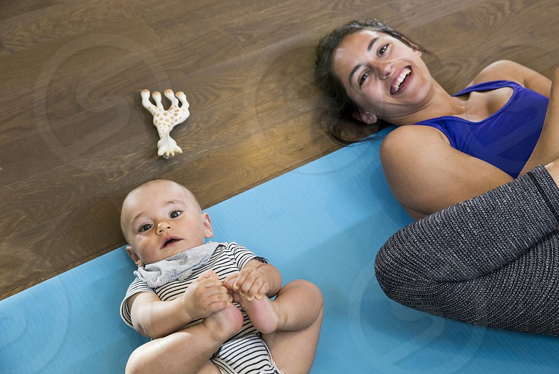 Mother and son in happy baby yoga pose in Boulder Colorado photo