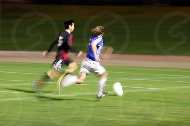 Passing him - soccer photo