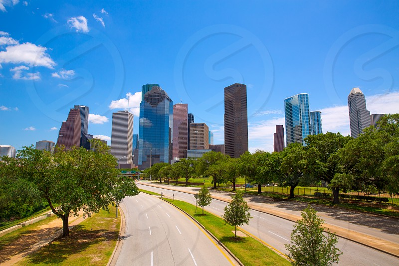Houston Texas Skyline with modern skyscapers and blue sky view from road photo