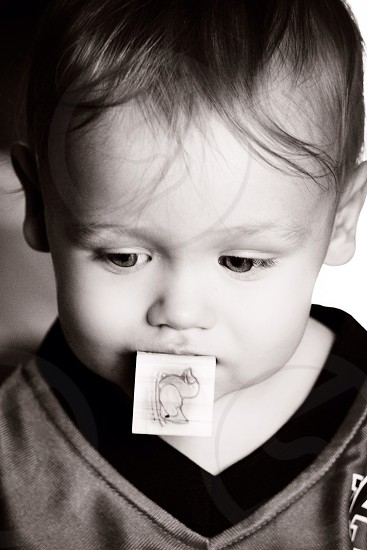 Son toddler boy block eyes black and white face close up  photo