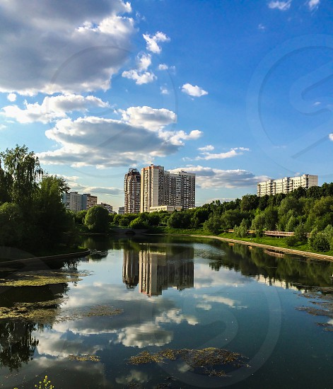 Moscow city Park lake reflection sky clouds buildings summer  photo